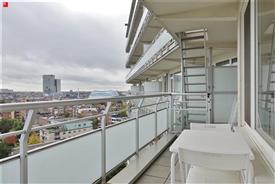 Ruim één slaapkamer appartement met ondergrondse parkeerplaats te huur in Gent