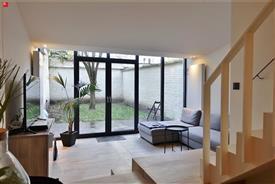 Stijlvol duplexappartement met tuin te huur in Gent