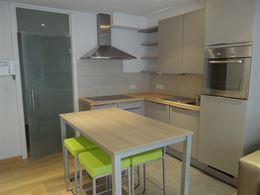 TE HUUR OP JAARBASIS - ongemeubelde studio met slaaphoek - moderne uitgerust - open ingerichte keuken met frigo, oven, vaatwas en keramisch fornuis - ...